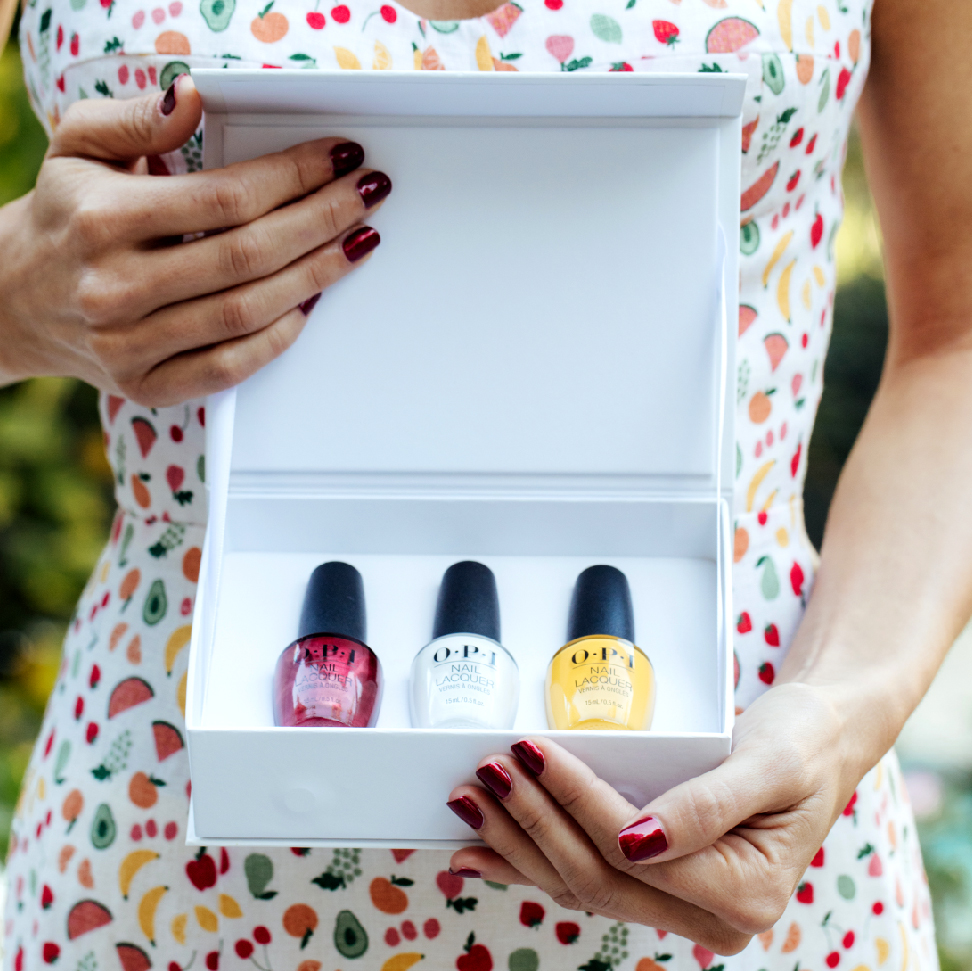 White open gift box with three OPI nail polishes